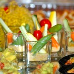 Individual crudite glass with roasted red pepper, feta and mint dip