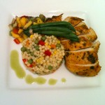 Grlled herb chicken breast, bundle of green beans, fresh fruit salsa and Israeli couscous with peas ans mango