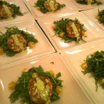 Almond coated salmon cake with fresh white wine chive mayo on bed of arugula