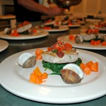 Mahi Mahi over a Bed of Sauteed Spinach, Glazed Carrots and Baby Clams
